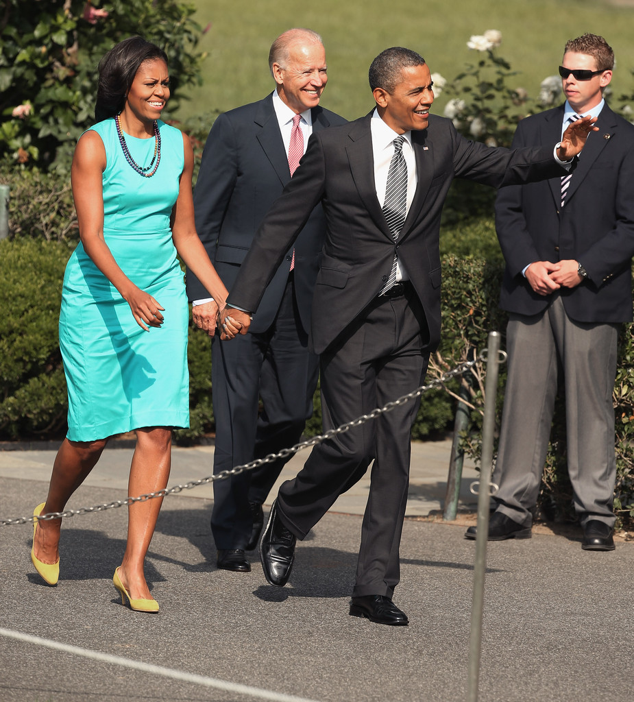 822c4252bf Michelle Obama was in the mood for color, pairing yellow pumps with her  turquoise dress