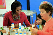 Michelle Obama added lots of flair to her outfit with a beaded collar necklace when she visited a Maryland elementary school.