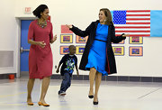 Michelle Obama finished off her color-block look with orange ballet flats.