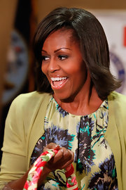Michelle Obama wore her hair in a retro-chic feathered flip during a pre-Easter celebration with military families.