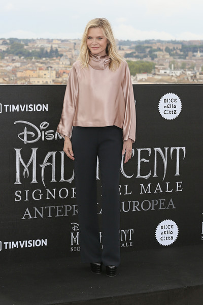 Michelle Pfeiffer Slacks [maleficent -- mistress of evil,clothing,fashion,footwear,font,trousers,photography,jeans,t-shirt,neck,shoe,michelle pfeiffer,photocall,photocall,italy,rome,hotel de la ville]