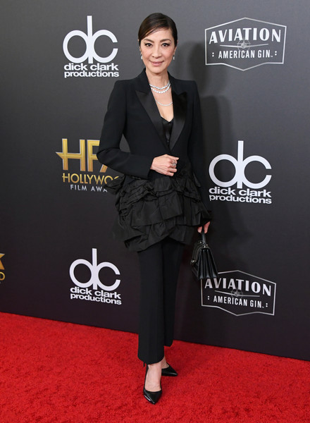 Michelle Yeoh Pantsuit [red carpet,carpet,clothing,suit,premiere,fashion,footwear,formal wear,flooring,outerwear,the beverly hilton hotel,beverly hills,california,22nd annual hollywood film awards - arrivals,annual hollywood film awards,michelle yeoh]