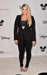 Meghan Trainor teamed black leggings with a sparkling bandeau top for Mickey's 90th Spectacular.