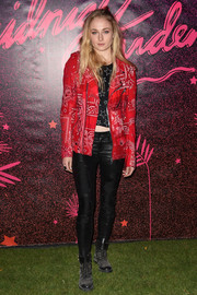 Sophie Turner layered a red paisley biker jacket over a star-print crop-top for the Midnight Garden After Dark party.