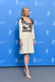Kirsten Dunst was demure and classy at the 'Midnight Special' photocall in a white Gucci dress adorned with a beaded bird on the bodice.