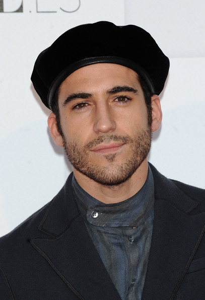 Miguel Angel Silvestre Beret [facial hair,beard,chin,hat,headgear,cap,moustache,neck,fedora,white-collar worker,miguel angel silvestre,vogue fashion night out 2010,madrid,spanish,spain]