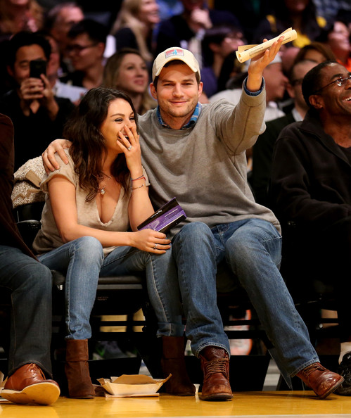 Mila Kunis Ankle Boots [people,audience,event,yellow,crowd,fashion,performance,jeans,sitting,video board,ashton kucher,actors,user,note,feature,camera,los angeles lakers,oklahoma city thunder,game]