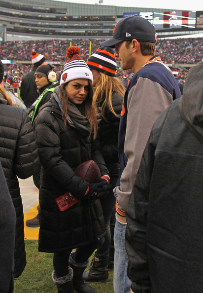 Mila Kunis Puffa Jacket [people,crowd,product,event,tree,headgear,fan,team,competition event,american football,mila kunis,ashton kutcher,sidleines,soldier field,illinois,chicago,chicago bears,green bay packers]