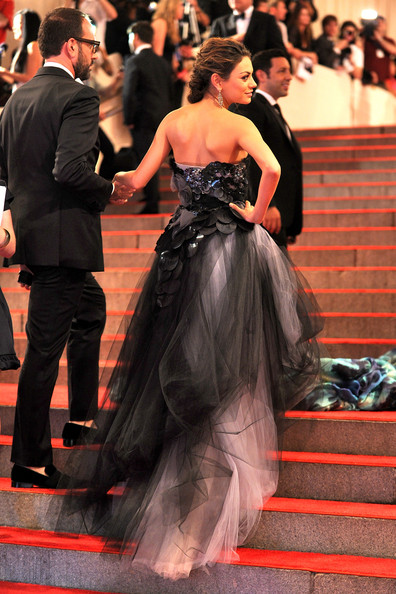 Mila Kunis Messy Updo [american woman: fashioning a national identity,gown,dress,red carpet,clothing,carpet,strapless dress,formal wear,flooring,premiere,event,mila kunis,arrivals,costume institute gala benefit,metropolitan museum of art,new york city,met gala,opening,exhibition]
