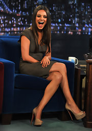 We can't get enough of this gorgeous and stylish star! Mila Kunis made an appearance on Late Night With Jimmy Fallon in a jacquard Roland Mouret cocktail dress. The actress wore her sleek brown locks down in a straight style and kept her look clean with a pair of nude peep-toe pumps.