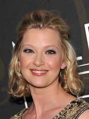 Gretchen Mol attended the premiere of 'Mildred Pierce' wearing Finn 18-karat yellow gold branch hoop earrings.