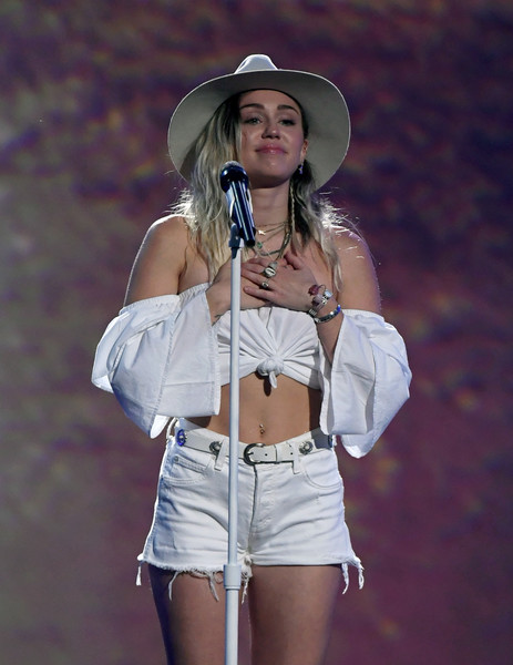 Miley Cyrus Bangle Bracelet [white,clothing,beauty,abdomen,fashion,leg,waist,shorts,thigh,human body,miley cyrus,billboard music awards,t-mobile arena,las vegas,nevada,show]