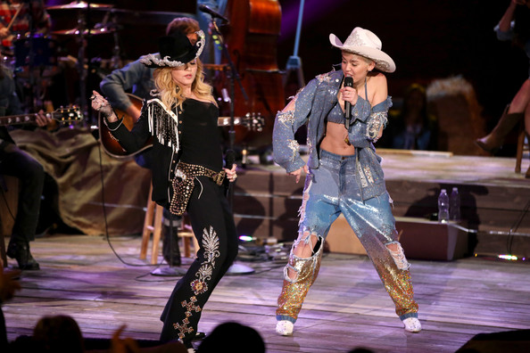 Miley Cyrus Ripped Jeans [mtv unplugged: miley films,mtv unplugged,performance,entertainment,performing arts,event,music,performance art,public event,music artist,stage,dance,miley cyrus,artists,madonna,hollywood,california,sunset gower studios,l]