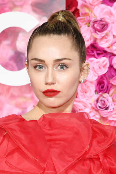 Miley Cyrus Ponytail [isnt it romantic,hair,face,lip,pink,hairstyle,eyebrow,beauty,cheek,eyelash,eye,arrivals,miley cyrus,california,los angeles,the theatre,ace hotel,warner bros. pictures,premiere,premiere]