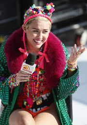 Miley Cyrus went OTT with layers of beaded bracelets, matching necklaces, and a bedazzled coat for an interview in Sydney, Australia.