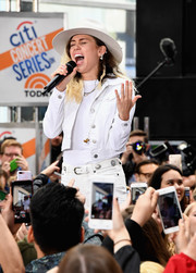 Miley Cyrus styled her white look with an embellished leather belt for her performance on NBC's 'Today.'