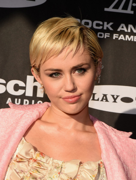 Miley Cyrus Pixie [hair,face,hairstyle,blond,eyebrow,chin,lip,eyelash,shoulder,bangs,arrivals,miley cyrus,cleveland,ohio,public hall,rock and roll hall of fame induction ceremony]