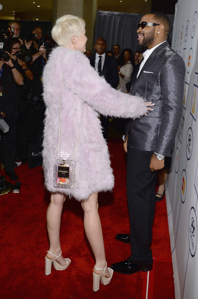 Miley Cyrus Printed Shoulder Bag [red carpet,red carpet,carpet,fashion,fur,flooring,event,footwear,fur clothing,premiere,fashion design,mike will made it,miley cyrus,lucian grainge,salute to industry icons,the beverly hilton,beverly hills,california,56th annual grammy awards,grammy awards pre-grammy gala]