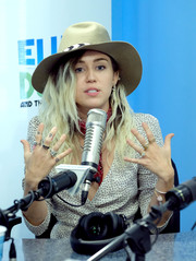 Miley Cyrus loaded up on the bling for her visit to 'The Elvis Duran Z100 Morning Show.'