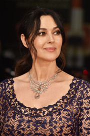 Monica Bellucci rounded out her glamorous look with a pearl and diamond chandelier necklace.