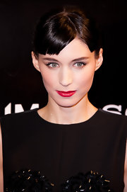 Rooney Mara wore a pop of classic red lipstick to brighten up her black ensemble at the Paris premiere of 'Millenium: The Girl With the Dragon Tattoo.'