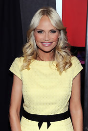 Kristin Chenoweth attended the Milly by Michael Smith runway show, wearing her long blonde tresses in a wavy center part.