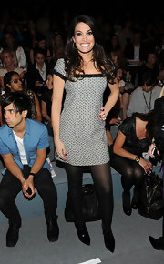 Kimberly Guilfoyle wore a mini dress that had a stylish '60s vibe to the Milly fashion show.