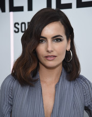 Camilla Belle rounded out her look with a pair of oversized sterling hoops.