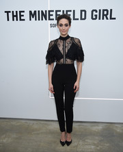 Emmy Rossum complemented her jumpsuit with black patent pumps by Paul Andrew.