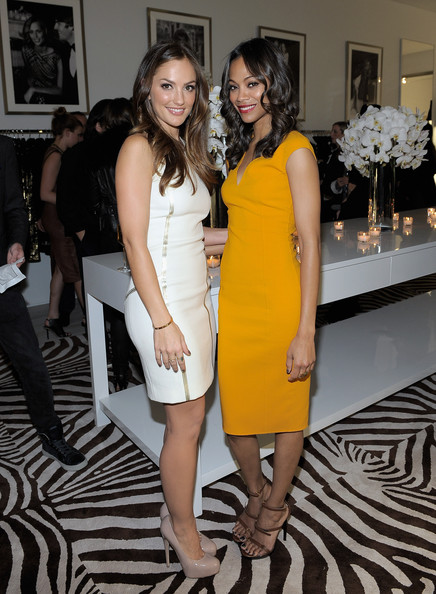 Actresses Minka Kelly (L) and Zoe Saldana attend the opening of the new ...