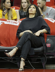 Kylie Jenner sat courtside at the Western Conference playoffs wearing an oversized black tee by Balenciaga.