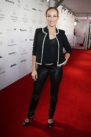 Sonja added a classic black jacket with white trim to her draped blouse and leather pants.