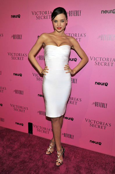 Miranda Kerr Strapless Dress [bombshell summer edition,what is sexy,dress,cocktail dress,clothing,shoulder,fashion model,strapless dress,hairstyle,pink,fashion,joint,sexy,miranda kerr,list,the beverly,california,victorias secret,launch party,celebration]