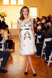 Miranda Kerr struck a romantic note with this floral-embroidered, sheer-overlay Erdem dress at the Kora Organics media call.