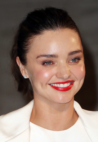 Miranda Kerr Red Lipstick [eyebrow,lip,beauty,cheek,chin,nose,eyelash,hairstyle,forehead,smile,miranda kerr,arrivals,la,california,panthere de cartier party,milk studios]