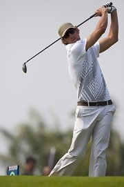 Michael Phelps golfed in a plain khaki baseball cap.