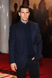 Tom Cruise looked debonair in a navy blazer over a crewneck sweater for the 'Mission: Impossible' photocall.