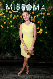 Kate Bosworth styled her frock with gold ankle-strap heels.