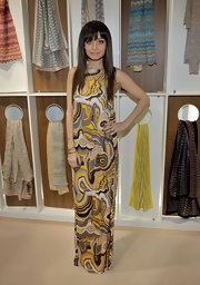 Nicole sported a printed Missoni frock to the store opening with a straight and layered hairstyle. Her piecey bangs highlighted her eyes and framed her face.