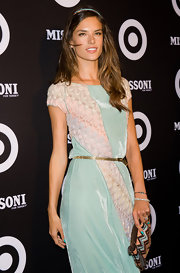 Alessandra cinched her waist with this tiny gold belt.