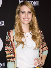 Emma Roberts was casually cool at the Missoni For Target Collection Launch. She created a deep side part, swept her bangs off to the side and added a few waves with a large-barreled curling iron.