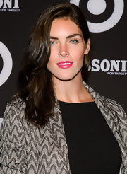 Hilary Rhoda styled her hair with gentle waves for added volume.