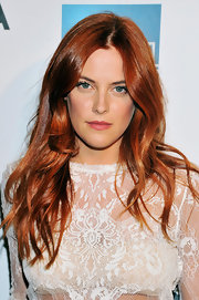 Riley Keough showed off her red locks with a shiny naturally wavy 'do.