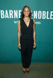 Misty Copeland paired her jumpsuit with purple pumps for a subtle pop of color.
