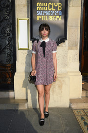 Ana de Armas teamed her frock with a pair crystal-adorned patent loafers, also by Miu Miu.