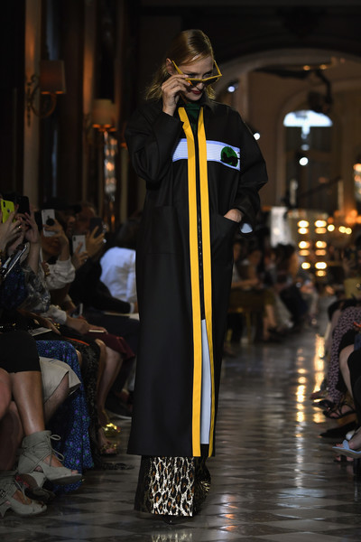 Uma Thurman channeled her inner wizard in a black coat with yellow and blue trim while walking the Miu Miu Cruise 2019 show.