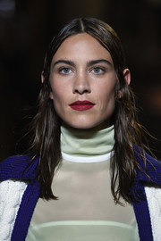 Alexa Chung sported a wet-look 'do while walking the Miu Miu Cruise 2019 show.