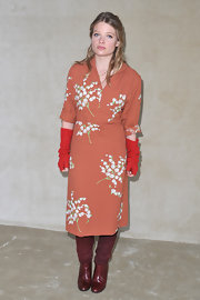 Melanie Thierry wore a peach print dress with this eclectic ensemble for the Miu Miu show in Paris.