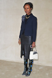 Shala Monroque rocked a black leather pencil skirt with a thigh-high front slit during the Miu Miu fashion show.