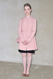 Mia Wasikowska was pretty in pink at the Miu Miu show in a sweet Peter Pan-collared coat.
